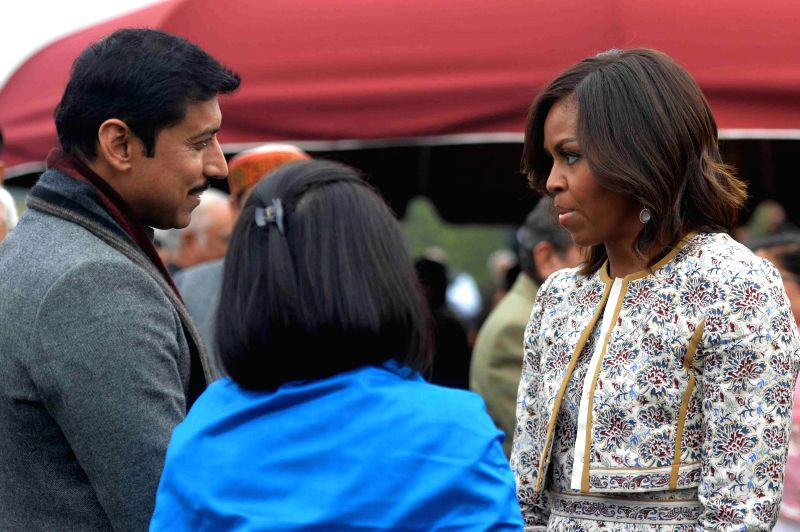 First Lady Michelle Obama with the Union Minister of State Information and Broadcasting Col. Rajyavardhan Singh Rathore during the  `At Home` function organised by President Pranab ... - Rajyavardhan Singh Rathore and Pranab Mukherjee