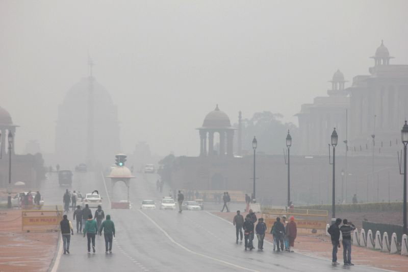Fog covers the Rashtrapati Bhawan during winter rains in New Delhi on Dec 14, 2014.