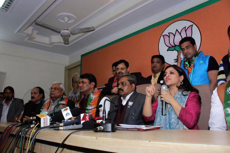Former Aam Aadmi Party MLA Vinod Kumar Binny joins BJP in presence of Delhi BJP chief Satish Upadhyay in New Delhi, on Jan 18, 2015. Also seen BJP leader Shazia Ilmi. - Satish Upadhyay