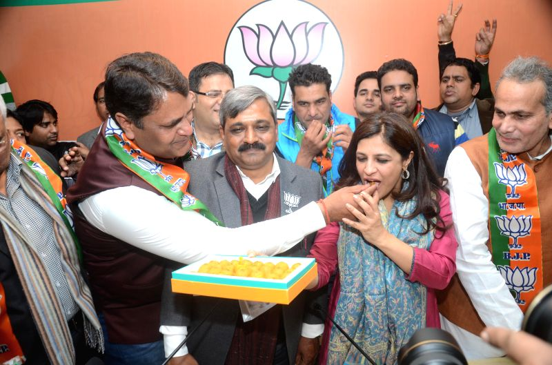 Former Aam Aadmi Party MLA Vinod Kumar Binny joins BJP in presence of Delhi BJP chief Satish Upadhyay, party leader Shazia Ilmi and others in New Delhi, on Jan 18, 2015. - Satish Upadhyay