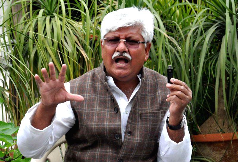 Former Congress MLA Asif Mohammed Khan addresses apress conference in New Delhi, on March 13, 2015. - Asif Mohammed Khan