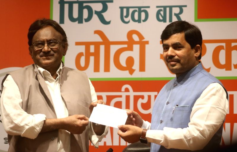 New Delhi: Former IAS Officer S. Krishnakumar joins BJP in the presence of party leader Syed Shahnawaz Hussain, at the party's headquarter in New Delhi on April 20, 2019. (Photo: IANS)