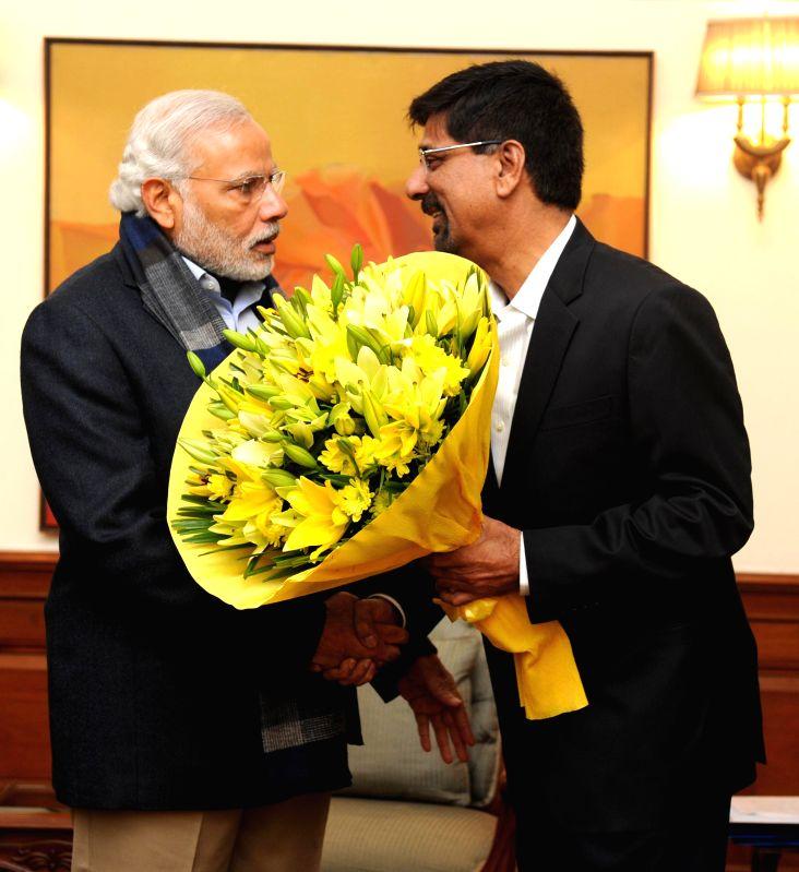 Former Indian cricketer K. Srikkanth calls on Prime Minister Narendra Modi in New Delhi on Dec 30, 2014. - Narendra Modi