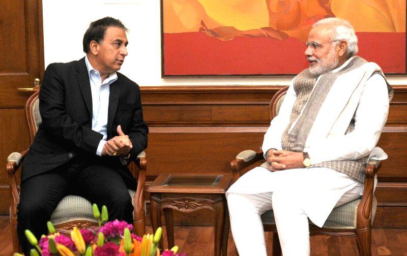 Former Indian Cricketer Sunil Gavaskar calls on the Prime Minister Narendra Modi, in New Delhi on Dec 6, 2014. - Narendra Modi