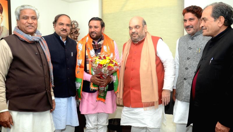 Former INLD leader Avtar Singh Bhadana joins BJP in presence of party chief Amit Shah in New Delhi on Feb. 2, 2015. - Amit Shah