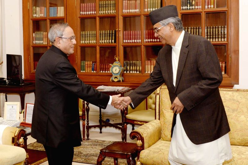 Former Nepal prime minister Sher Bahadur Deuba calls on President Pranab Mukherjee at Rashtrapati Bhavan in New Delhi, on Nov 19, 2014. - Sher Bahadur Deuba and Pranab Mukherjee