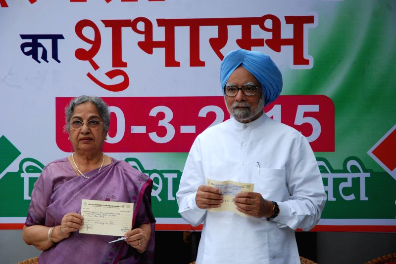 Former prime minister Dr Manmohan Singh with his wife Gursharan Kaur at the launch of party's membership drive in New Delhi, on March 30, 2015. - Gursharan Kaur
