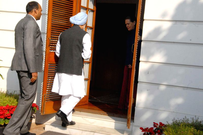 Former Prime Minister Manmohan Singh arrives to attend Congress Working Committee meeting in New Delhi, on Nov 25, 2014. - Manmohan Singh