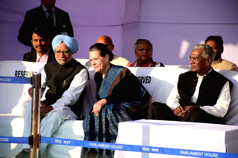 Former Prime Minister Manmohan Singh and Congress president Sonia Gandhi in conversation prior to paying their tributes to Babasaheb Dr B R Ambedkar on his 59th Mahaparinirvan Diwas in New - Manmohan Singh and Sonia Gandhi