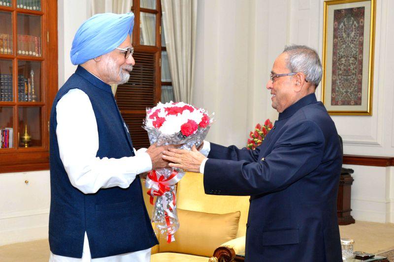 Former Prime Minister of India Manmohan Singh calls on President Pranab Mukherjee to greet him on his 78th birthday at Rashtrapati Bhavan in New Delhi, on Dec 11, 2014. - Pranab Mukherjee