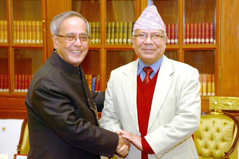 Former prime minister of Nepal Madhav Nepal calls on President Pranab Mukherjee at Rashtrapati Bhawan in New Delhi, on Nov 19, 2014. - Pranab Mukherjee