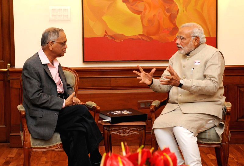 Founder of Infosys N.R. Narayana Murthy calls on Prime Minister, Narendra Modi, in New Delhi on Dec 5, 2014. - Narendra Modi