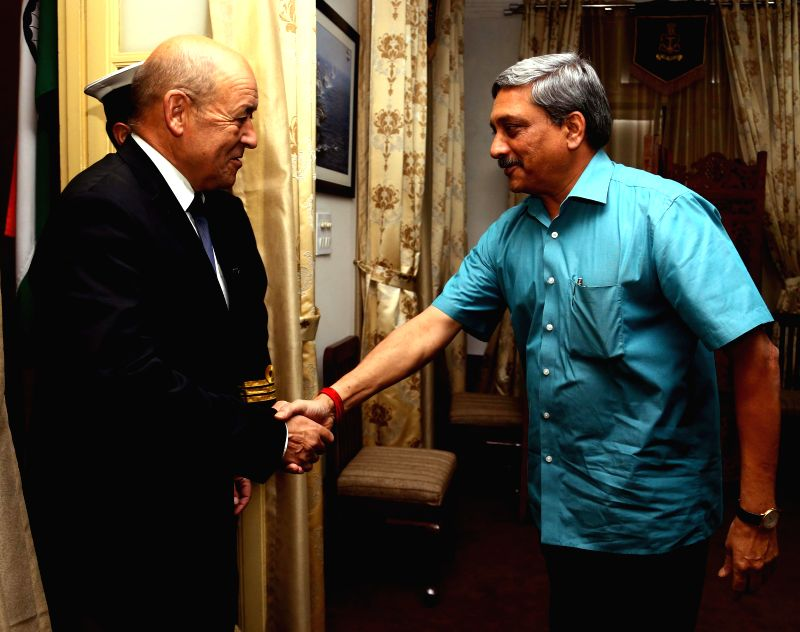 French Defence Minister H.E. Jean-Yves Le Drian calls on Union Defence Minister Manohar Parrikar in New Delhi, on Dec 1, 2014. The French Minister is on a three-day visit to India. - H.