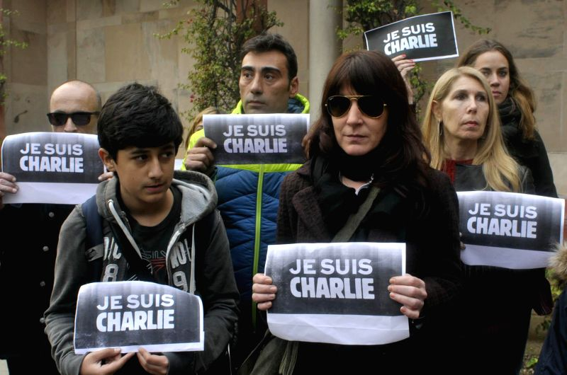 French people stage a protest against the massacre of 12 people at the office of a French satirical magazine in Paris, inside the French embassy in New Delhi, on Jan 8, 2015.