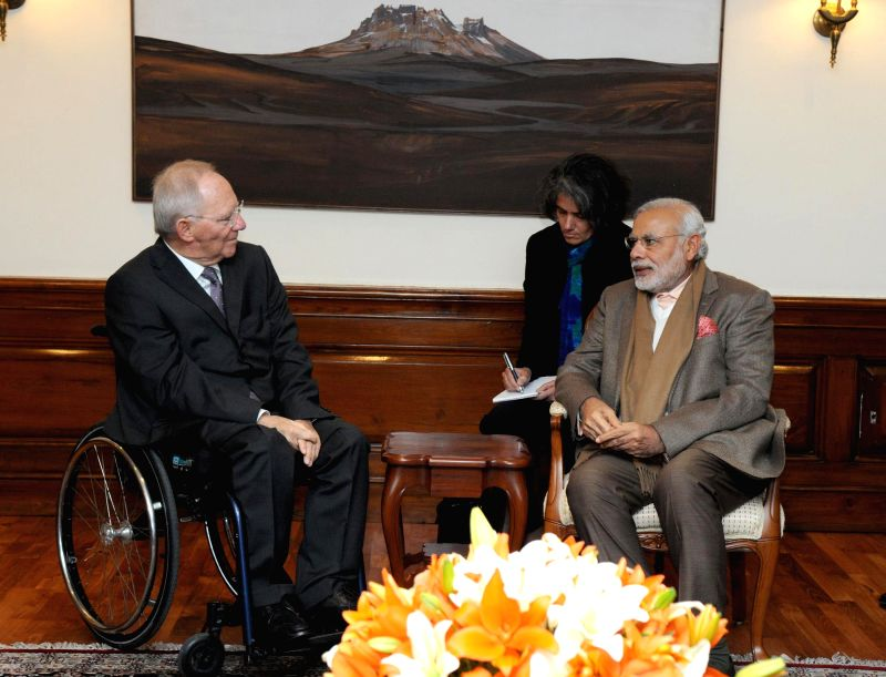 German Finance Minister Wolfgang Schauble calls on the Prime Minister Narendra Modi in New Delhi on Jan 19, 2015. - Wolfgang Schauble and Narendra Modi