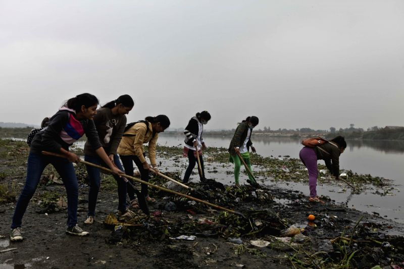 Girls participate in the clean-up programme of the Yamuna river organised by the Ministry of Youth Affairs and Sports, United Nations Volunteers, United Nations Development Programme and ..