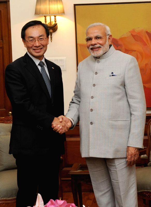 Global President of Panasonic Corporation, Kazuhiro Tsuga calls on Prime Minister Narendra Modi, in New Delhi on Dec 4, 2014. - Narendra Modi