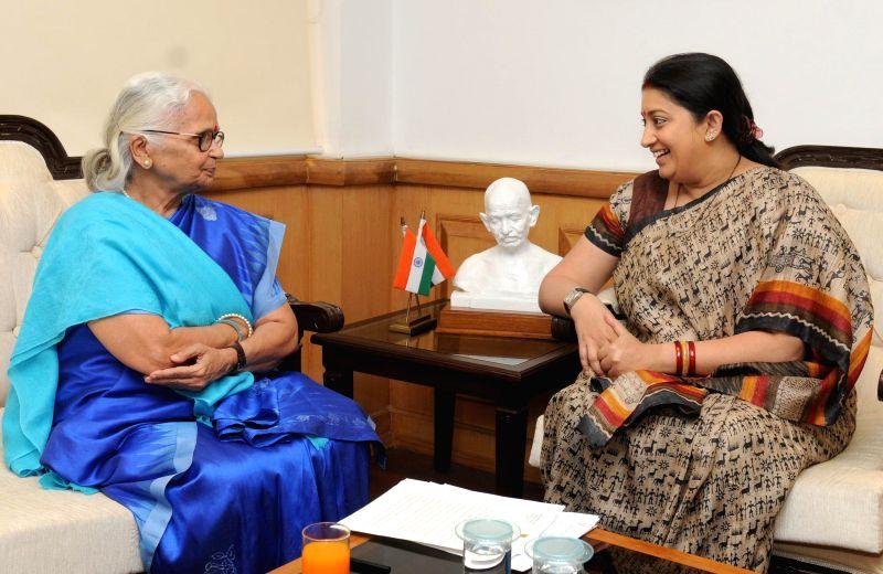 Goa Governor Mridula Sinha calls on the Union Minister for Human Resource Development Smriti Irani in New Delhi on March 13, 2015. - Mridula Sinha