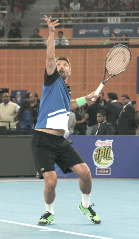 Goran Ivanisevic of UAE Royals in action against Mark Philippoussis of Manila Mavericks during an IPTL men's singles match at Indira Gandhi Indoor Arena in New Delhi, on Dec 7, 2014. ...