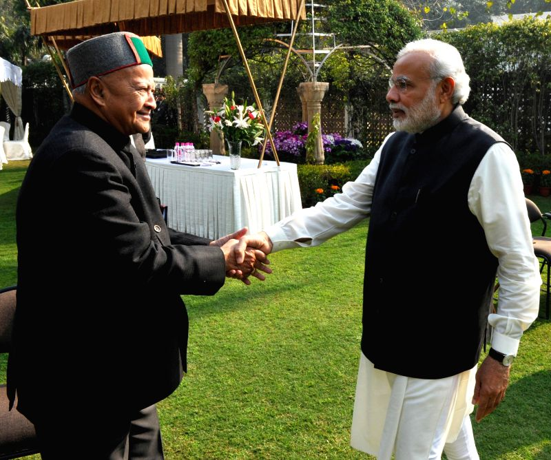 Himachal Pradesh Chief Minister Virbhadra Singh greets Prime Minister Narendra Modi during the meeting of Governing Council of NITI Aayog in New Delhi on Feb 8, 2015. - Virbhadra Singh and Narendra Modi