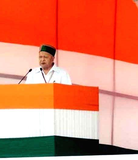 Himachal Pradesh Chief Minister Virbhadra Singh addresses during Congress' Kissan Rally at Ramlila Maidan in New Delhi, on April 19, 2015.