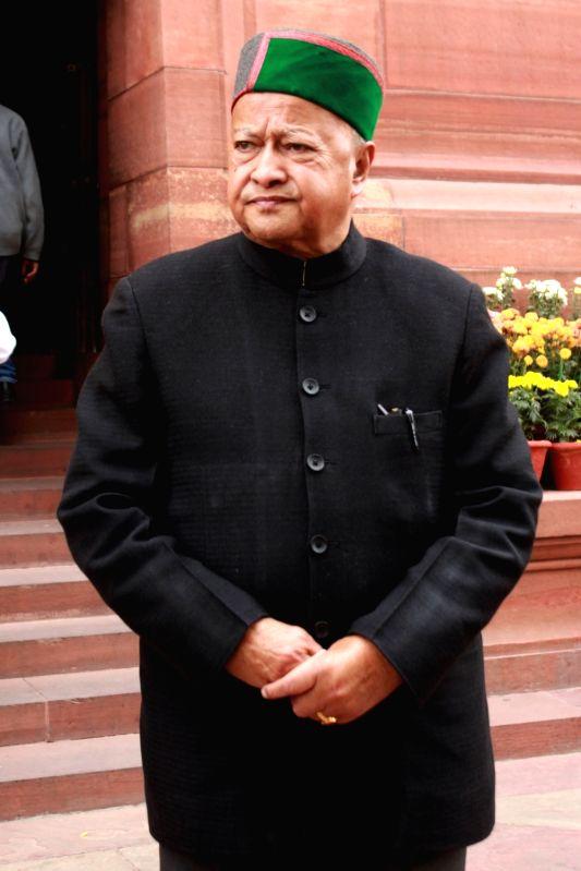 :New Delhi: Himachal Pradesh Chief Minister Virbhadra Singh at the Parliament in New Delhi, on Dec 10, 2015. . - Virbhadra Singh