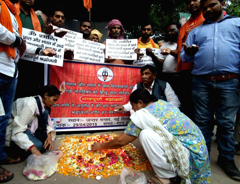 Hindu Sena activists pay tribute to the victims of Nepal earthquake at Jantar Mantar in New Delhi, on April 29, 2015.
