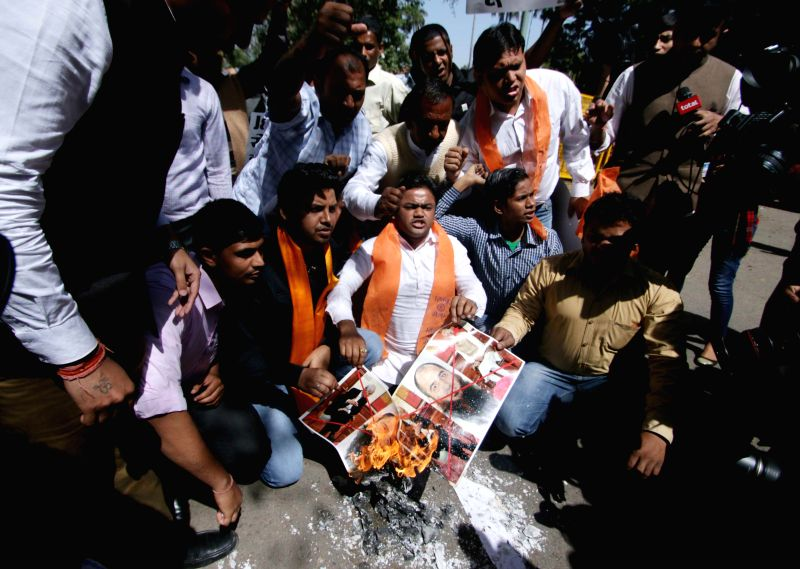 Hindu Sena activists stage a demonstration against BJP-PDP alliance, in New Delhi on March 9, 2015.