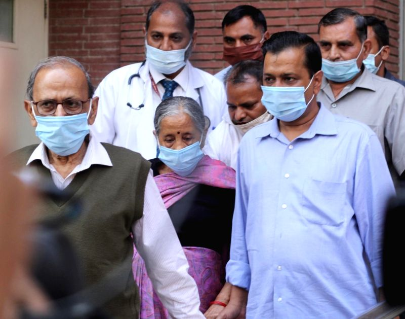 New Delhi: Hon'ble Chief Minister of Delhi Arvind Kejriwal with his mother and father coming out after receiving the first dose of COVID-19 vaccine at LNJP Hospital in New Delhi on Thursday 04th March, 2021. (Photo: IANS/Wasim Sarvar)