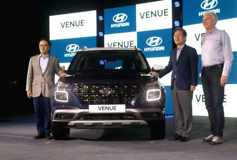 Hyundai Motor India MD and CEO S.S. Kim and Hyundai Global President and Head (R&D Division) Albert Biermann at the launch of Hyundai's new compact SUV 'Venue'