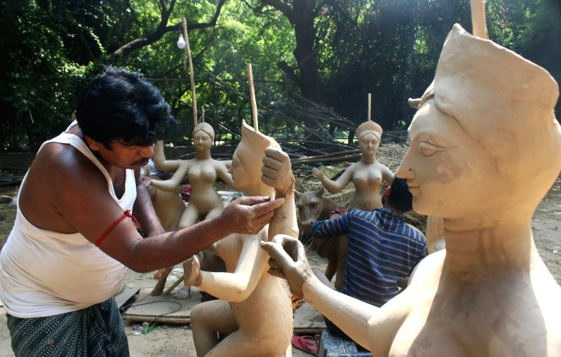 New Delhi: Idols of Goddess Durga being prepared at a workshop at CR Park ahead of Durga Puja celebrations, in New Delhi on Oct 7, 2020. (Photo: IANS)