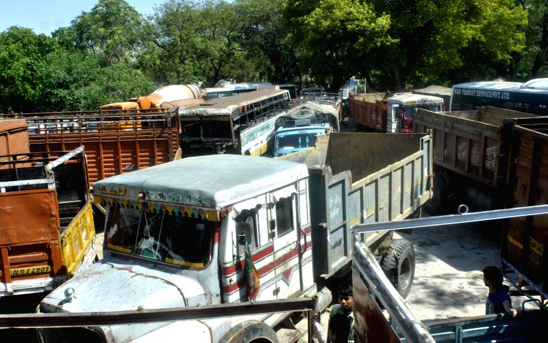 Impounded diesel vehicles parked in a Delhi depot as the National Green Tribunal has banned diesel vehicles older than 10 years from plying on the roads of the national capital, on April ...