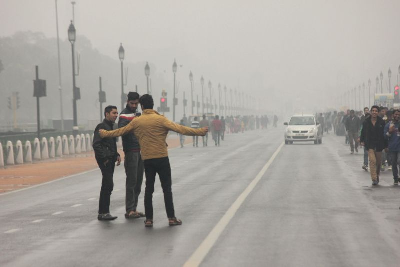 India Gate goes invisible on a foggy day in New Delhi, on Dec 14, 2014.