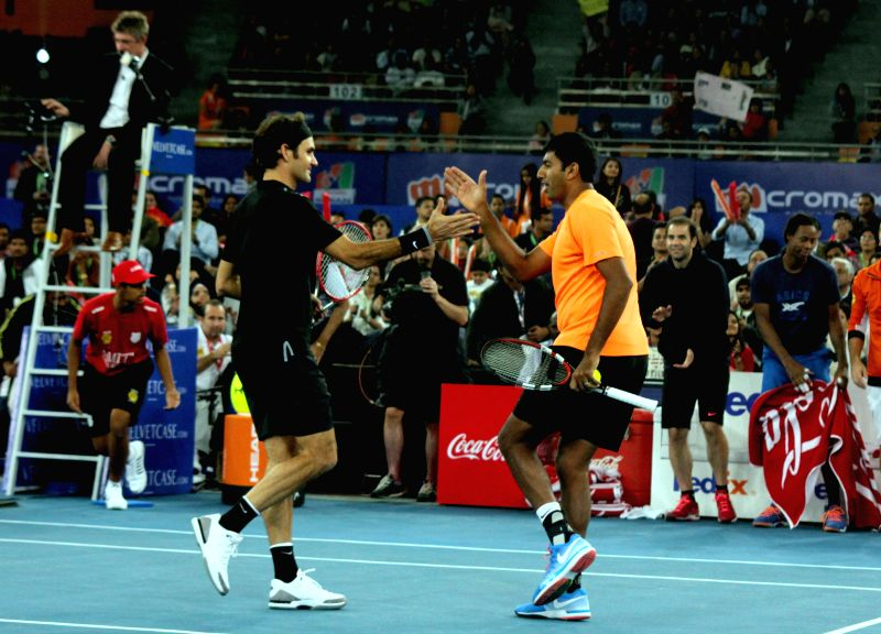 Indian Aces players Roger Federer and Rohan Bopanna during an IPTL men's doubles match at Indira Gandhi Indoor Arena in New Delhi, on Dec 7, 2014. Indian Aces won. Score: 6-1. - Rohan Bopanna