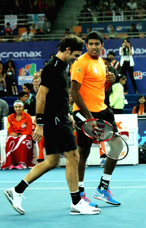 Indian Aces players Roger Federer and Rohan Bopanna during an IPTL men's doubles match against Lleyton Hewitt and Nick Kyrgios of Singapore Slammers at Indira Gandhi Indoor Arena in New .. - Rohan Bopanna