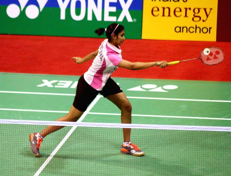 Indian badminton player Gadde Ruthvika Shivani returns a shot to her compatriot Saina Nehwal of India during a Yonex Sunrise Indian Open Badminton Championship match in New Delhi on March ...