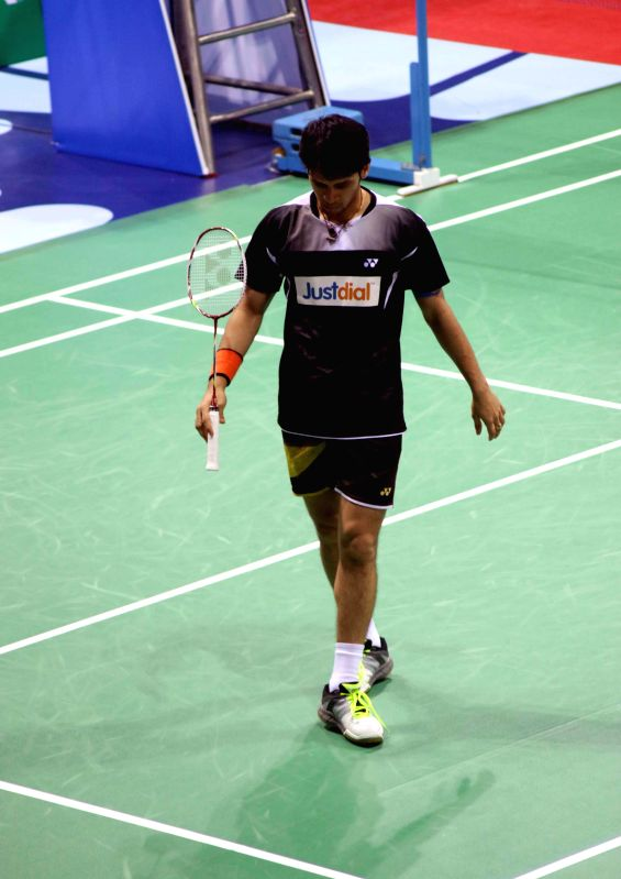 Indian badminton player Parupalli Kashyap returns a shot to Xue Song of China during a match of Yonex Sunrise Indian Open Badminton Championship in New Delhi on March 26, 2015. Parupalli ...