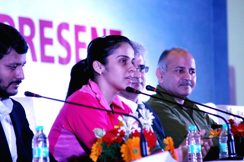 Indian badminton player Saina Nehwal addresses​ ​during​ the concluding ceremony of​ Junior Badminton Championship 2015 at the Thyagaraj Sports Complex in New Delhi on March 23, ...