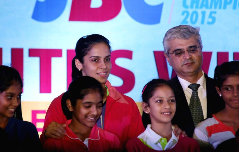 Indian badminton player Saina Nehwal addresses during the concluding ceremony of Junior Badminton Championship 2015 at the Thyagaraj Sports Complex in New Delhi on March 23, 2015. Also ...