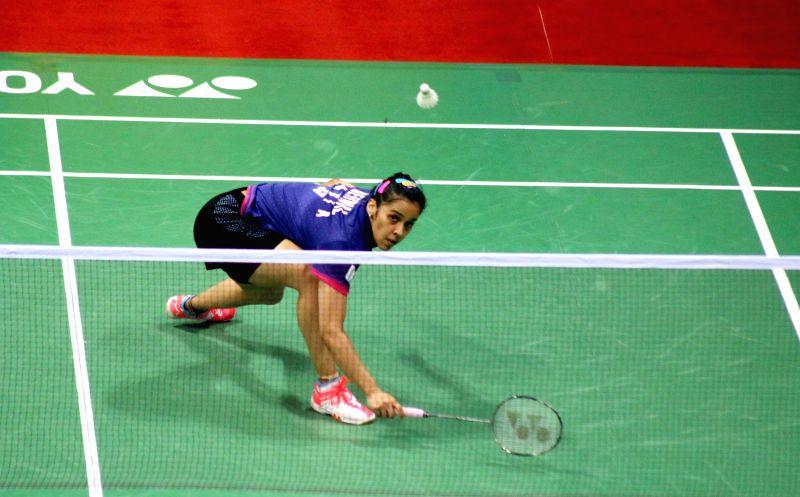 Indian badminton player Saina Nehwal returns a shot to her compatriot Gadde Ruthvika Shivani during a Yonex Sunrise Indian Open Badminton Championship match in New Delhi on March 26, 2015. ...