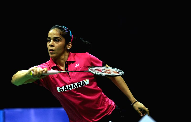 Indian badminton player Saina Nehwal returns a shot to Yui Hashimoto of Japan during a women`s singles match of Yonex Sunrise Indian Open Badminton Championship in New Delhi on March 28, ...