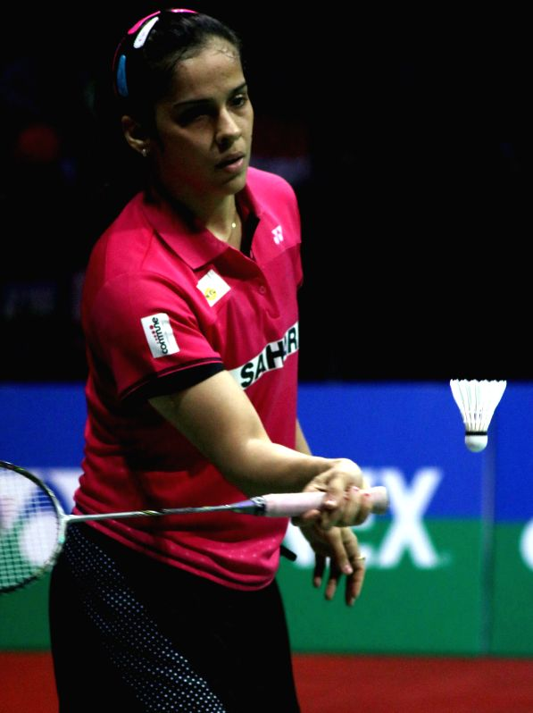 Indian badminton player Saina Nehwal returns a shot to Ratchanok Intanon of Thailand during Indian Open Badminton Championship in New Delhi on March 28, 2015. Saina Nehwal won. Score: ...