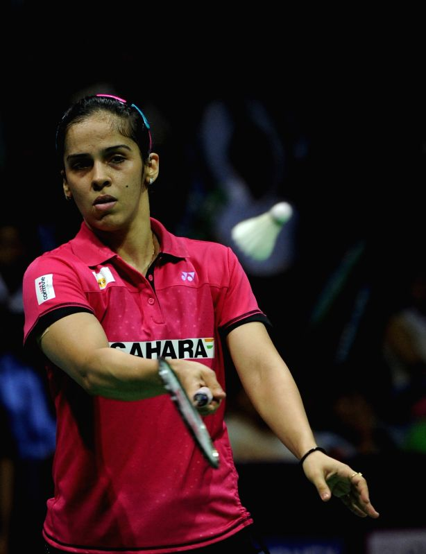 Indian badminton player Saina Nehwal returns a shot to Ratchanok Intanon of Thailand during Indian Open Badminton Championship in New Delhi on March 29, 2015. Saina Nehwal won.