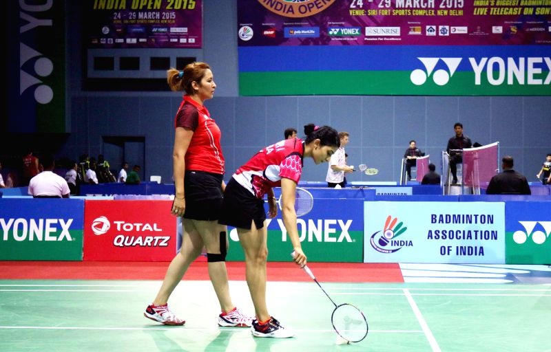 Indian badminton players Jwala Gutta and Ashwini Ponnappa during a Yonex Sunrise Indian Open Badminton Championship match against OU Dongni and Xiaohan Yu of China in New Delhi on March ...