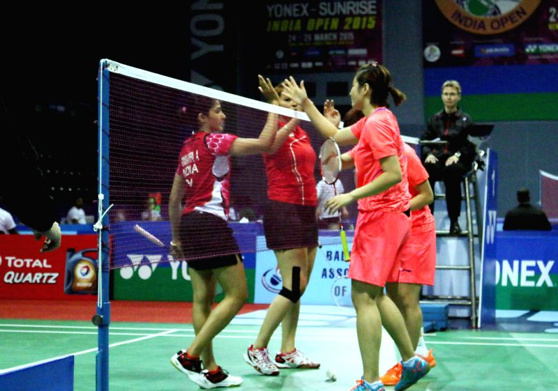 Indian badminton players Jwala Gutta and Ashwini Ponnappa with Chinese players OU Dongni and Xiaohan Yu during a Yonex Sunrise Indian Open Badminton Championship match in New Delhi on ...