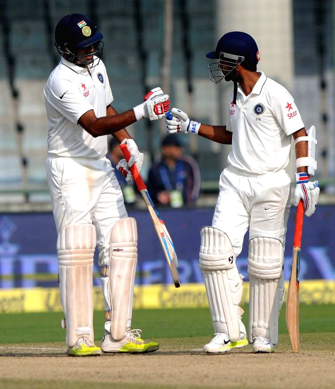 New Delhi: Indian batsmen Ajinkya Rahane and Ravichandran Ashwin during the second day of the Fourth and the final test match between India and South Africa at the Feroz Shah Kotla Stadium in New Delhi on Dec. 4, 2015.