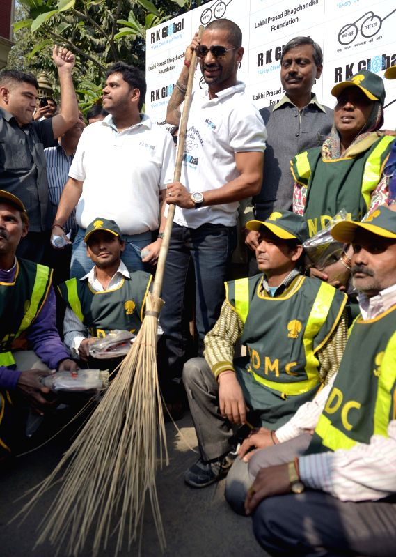 Indian cricketer Shikhar Dhawan participates in Clean India Campaign in New Delhi, on Nov 19, 2014.
