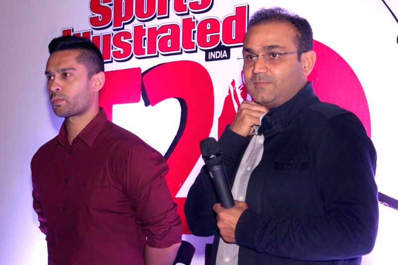 Indian cricketer Virender Sehwag and race driver Gaurav Gill during a programme organised to announce `Sports Illustrated T20 Cricket Corporate Championship` in New Delhi, on March 21, ...
