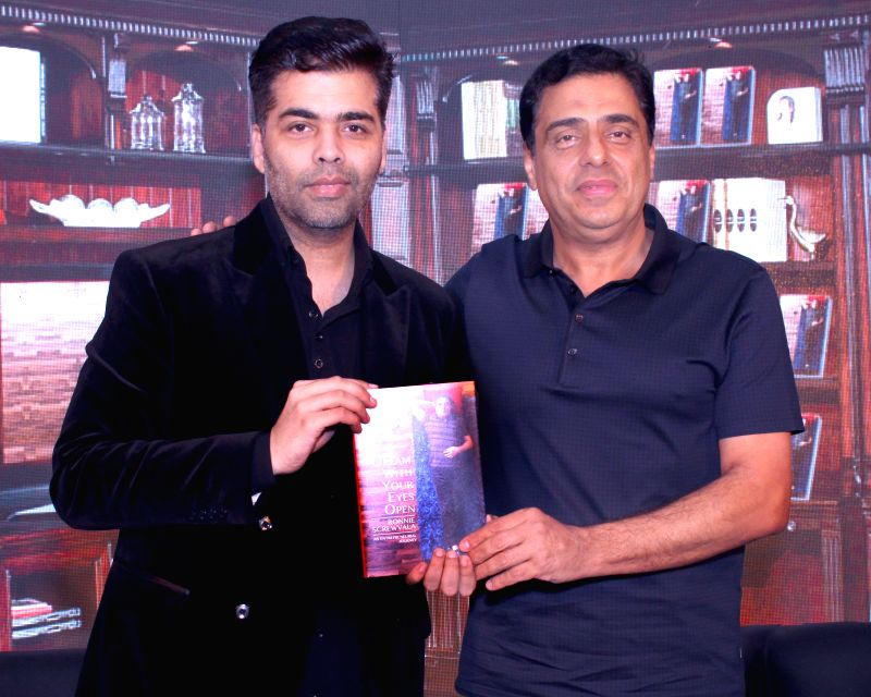Indian entrepreneur Ronnie Screwvala and filmmaker Karan Johar at the launch of his book `Dream With Your Eyes Open` in New Delhi, on April 8, 2015. - Karan Johar