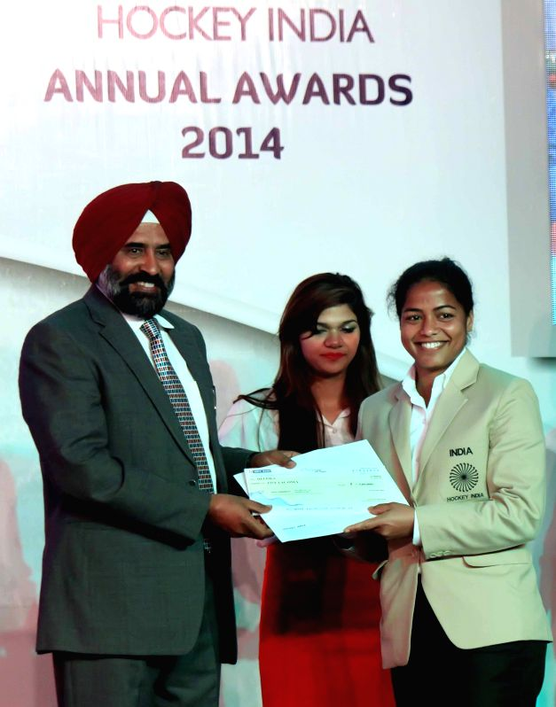 Indian hockey player Deepika honoured with a (Defender of the Year Award) at the inaugural of Hockey India Awards 2015 in New Delhi, on March 28, 2015.